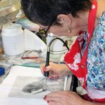 in-my-studio-dry-point-etching-a-plate