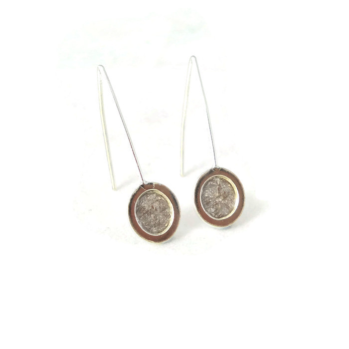 Front view of silver oval earrings
