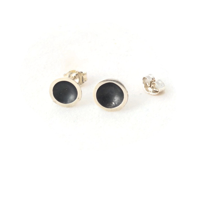 Domed studs with black centre