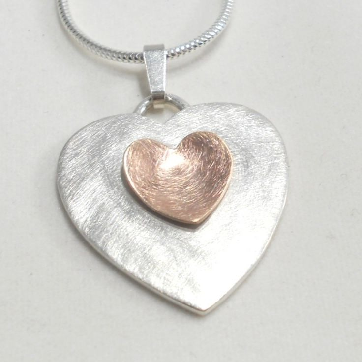 Pendant in sterling silver with rose gold heart