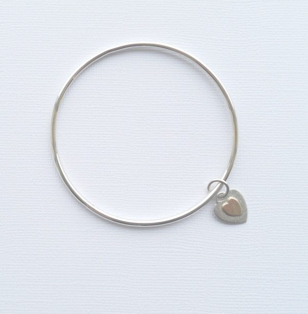 Silver bangle with gold heart