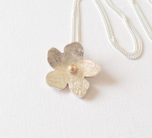 Hallmarked flower pendant