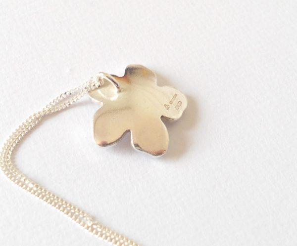 silver flower pendant with hallmark
